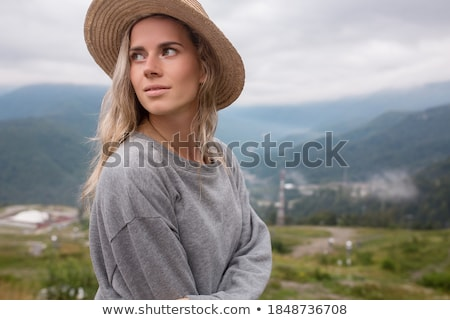 Female hiker rejoicing in the mountains Stock photo © dash