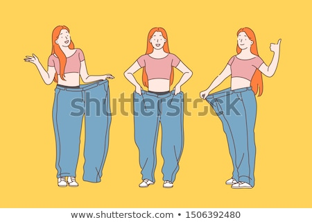 smiling woman showing her old jeans after successful diet stock photo © andreypopov