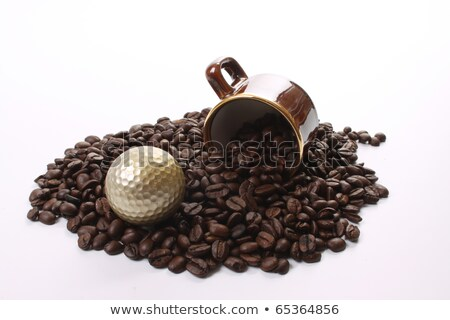 White cup of coffee and black golf ball  Stock photo © CaptureLight
