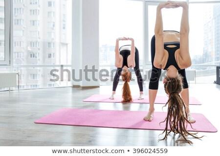 Iki kadın yalınayak pembe yoga mat Stok fotoğraf © deandrobot