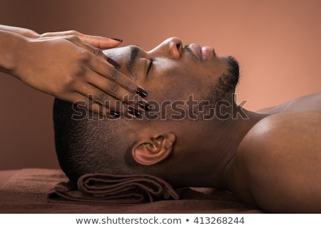Woman Receiving Forehead Massage In Spa Stock photo © AndreyPopov
