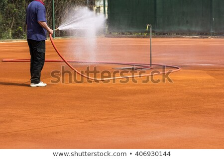 maintenance sprinkler tennis court  Stock photo © mikdam