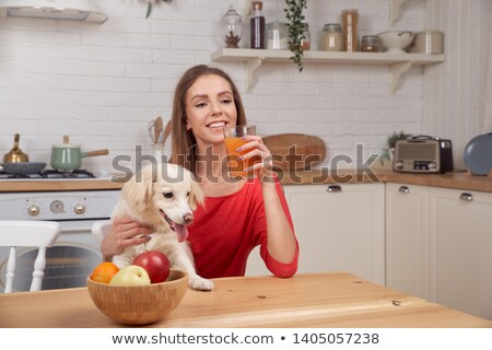 Stock photo: Beautiful young blonde girl with red apple, and a glass of juice.