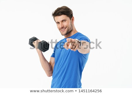 Confident young man athlete standing and pointing on you Stock photo © deandrobot