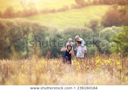 enjoying childhood at summer vacation walking on grass meadow stock photo © zurijeta