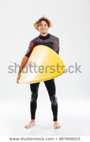 young handsome curly surfer holding surf board stock photo © deandrobot