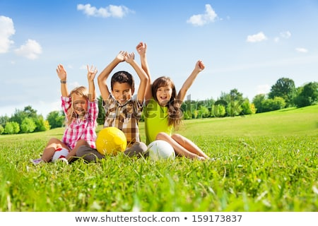three kids playing ball in the park stock photo © bluering