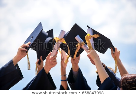 Man in graduation gown throwing cap Stock photo © bluering