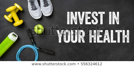 Fitness equipment on a dark background - Invest in your health Stock photo © Zerbor