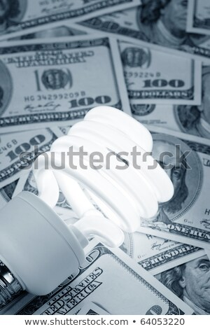 Compact Fluorescent Light bulb and dollar Stock photo © devon