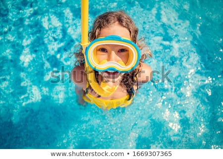 Girl with diving goggles in sea having summer vacation Stock photo © Kzenon