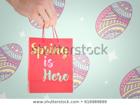 Stock photo: Hand holding red bag with with type against blue easter pattern