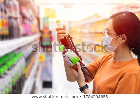 woman bying products in mall stock photo © deandrobot