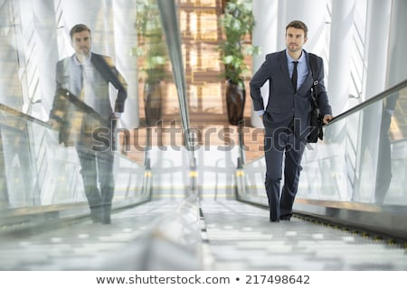Stock photo: Smiling businessman holding briefcase