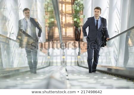 Mosolyog üzletember tart aktatáska mutat ok Stock fotó © LightFieldStudios