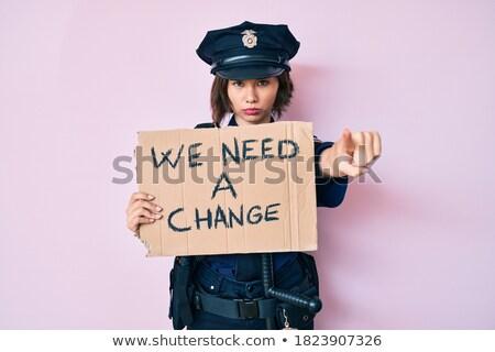Poważny policji kobieta uniform wskazując młodych Zdjęcia stock © RAStudio