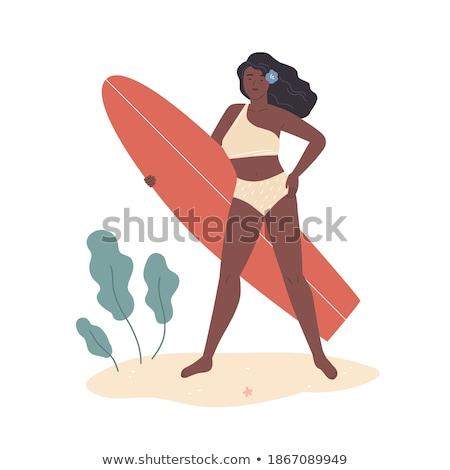 beautiful young female with surfboard in bikini in a tropical beach stock photo © alphaspirit