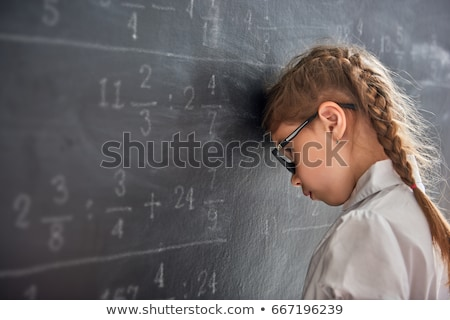 small cute kid on math lesson in the school stock photo © lordalea