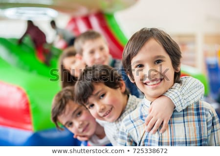 Happy children play in the bouncing house Stock photo © bluering
