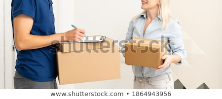 Courier Holding A Parcel And Electronic Clipboard Stock photo © monkey_business