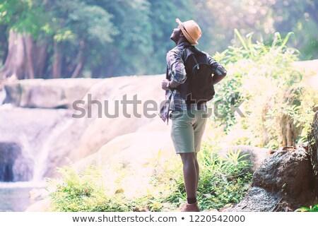 Jonge reiziger denken hand kin naar Stockfoto © RAStudio