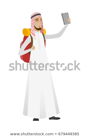 Muslim traveler man with backpack making selfie. Stock photo © RAStudio