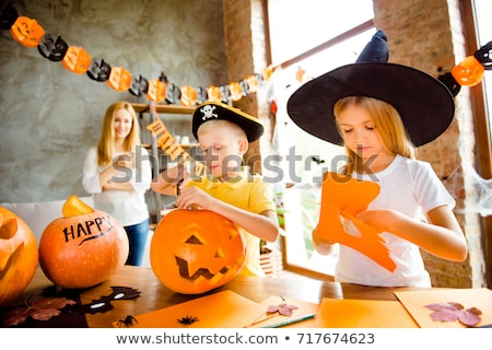 Two serious young women in halloween costumes stock photo © deandrobot