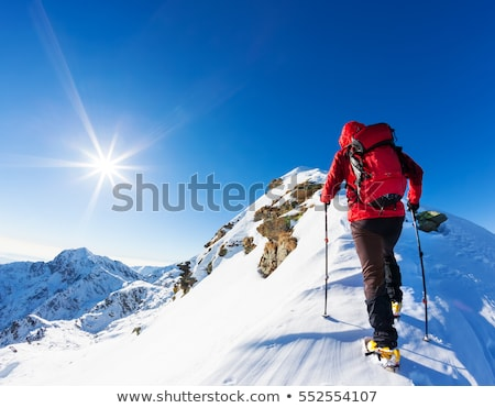 man climbing snowy mountain stock photo © is2