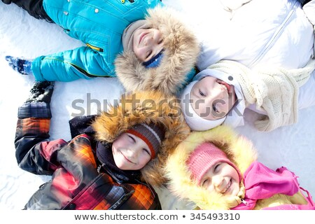 5 kids lying in the snow stock photo © is2