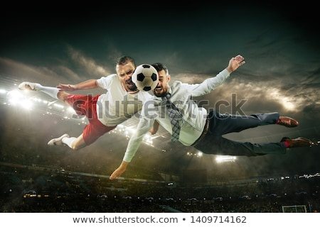 man plays with a soccerball in office Stock photo © IS2