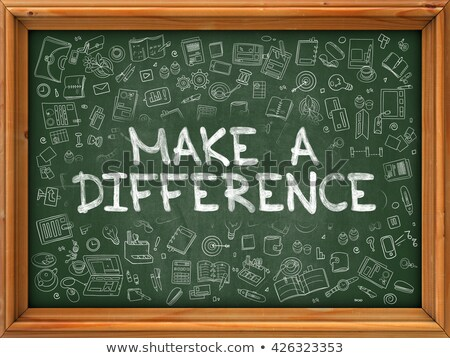 green chalkboard with hand drawn make a difference stock photo © tashatuvango