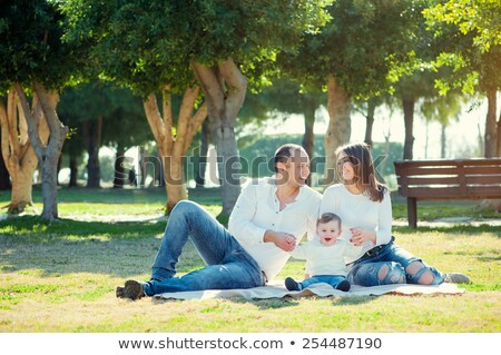 ストックフォト: Happy Young Family Spending Time Outdoor On A Summer Day Picnic