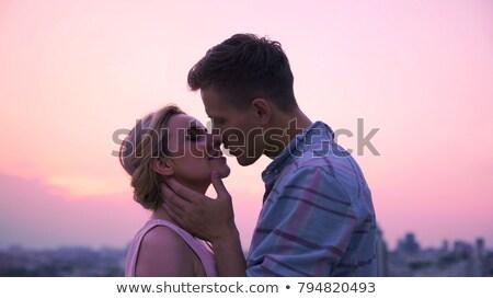 szerető · pár · csók · megbeszélés · hajnal · tető - stock fotó © motortion