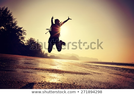 woman hiker with arms outstretched enjoy beach and sea stock photo © blasbike