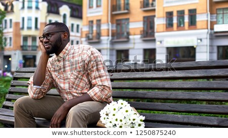Young man waiting for a date Stock photo © konradbak