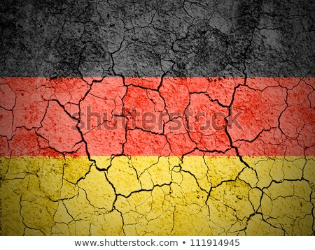 german flag on cracked ground background Stock photo © dolgachov
