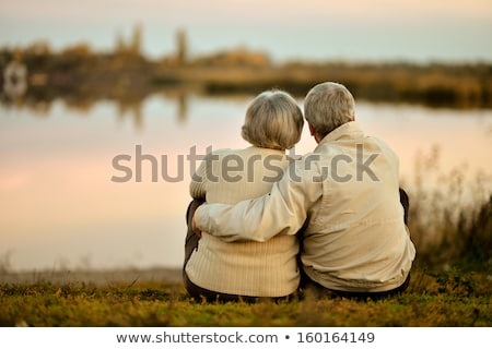senior couple by river embracing stock photo © is2