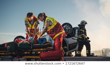 Paramedic performing CPR on patient in ambulance Stock photo © monkey_business