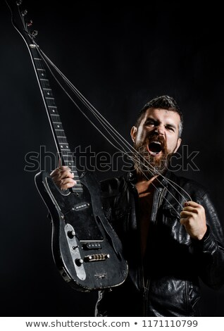 Barbu homme jouer basse guitare photo Photo stock © sumners