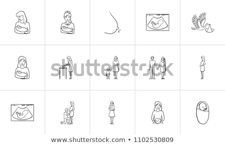 a woman with a fetus in womb hand drawn outline doodle icon stock photo © rastudio
