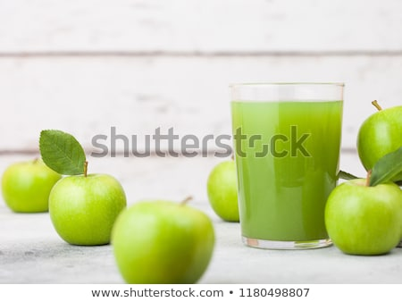 Stock photo: Glass of fresh organic apple juice with granny smith green apples in box on wooden background