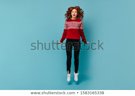 Full length portrait of astonished teenage girl with curly hair  Stock photo © deandrobot