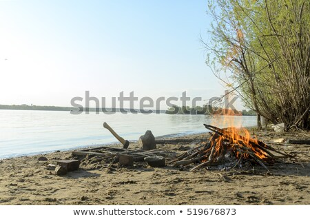 Firewood and campfire on riverside Stock photo © MikhailMishchenko