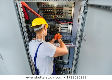 Electrician holding screwdriver and wire Stock photo © colematt