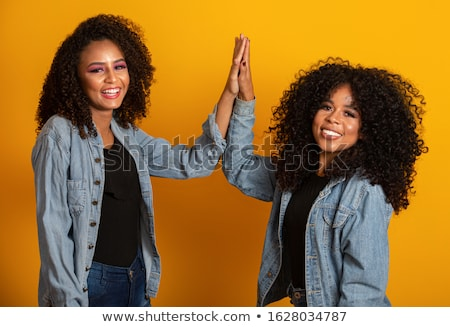 two pretty cheerful young girls friends stock photo © deandrobot