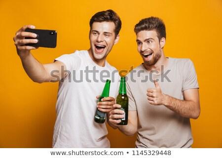 Maschio amici bottiglie bere celebrazione estate Foto d'archivio © dolgachov