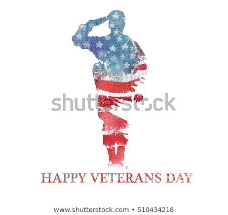 Stok fotoğraf: Veterans Day Soldier Saluting American Flag