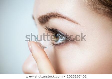 женщину · контактная · линза · пальца - Сток-фото © andreypopov