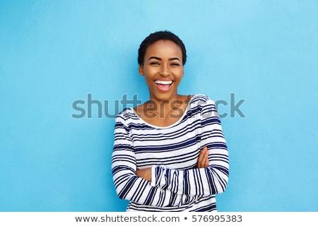 Jonge afro vrouw glimlachen amerikaanse vrouw poseren Stockfoto © NeonShot