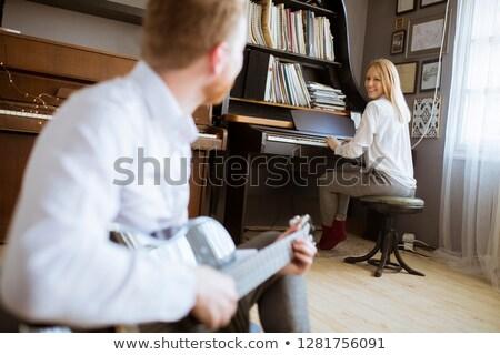 человека играет молодые красивая женщина дома Сток-фото © boggy